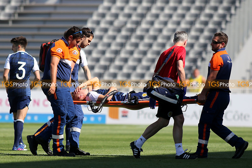 Ross McCrorie of Scotland is stretchered off in the first half during England Under-18 vs Scotland Under-20, Toulon Tournament Semi-Final Football at Stade Parsemain on 8th June 2017