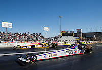 Mar 30, 2014; Las Vegas, NV, USA; NHRA top fuel driver Antron Brown (near) against Tony Schumacher during the Summitracing.com Nationals at The Strip at Las Vegas Motor Speedway. Mandatory Credit: Mark J. Rebilas-USA TODAY Sports
