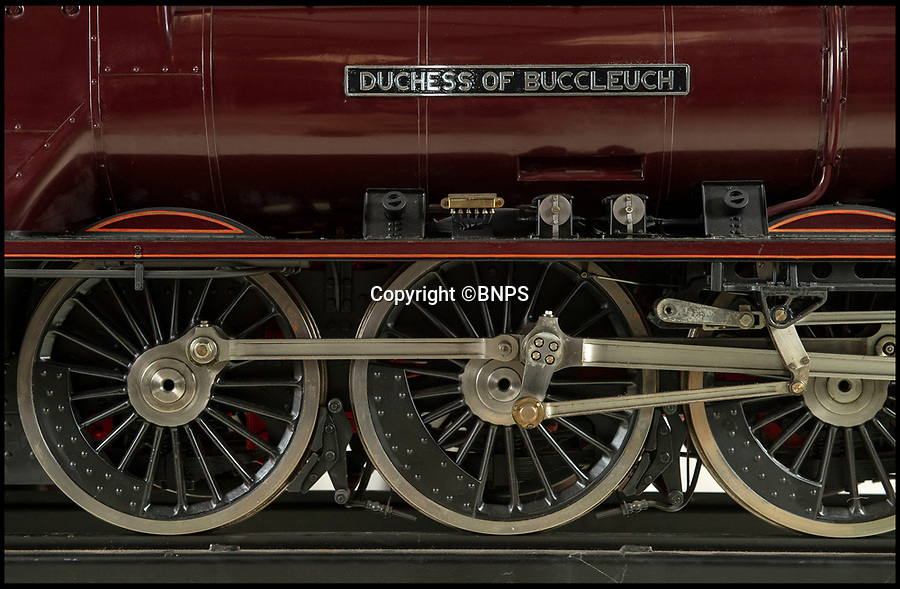 BNPS.co.uk (01202 558833)<br /> Pic: PhilYeomans/BNPS<br /> <br /> Track Record?- 'Best railway model ever built' is getting train buffs all steamed up.<br /> <br /> A stunning model train described as 'one of the best ever built' could break a world record when it goes under the hammer.<br /> <br /> The maroon coloured scaled down version of the 'Duchess of Buccleuch' is one of just two of that model made by legendary train builder Harry Powell.<br /> <br /> Its sister model sold for a world record £183,000 seven years ago - and it is hoped this one could top that sum.<br /> <br /> The 10ft model took Powell, who is regarded as the 'Rembrandt of model train making', 10 years and 18,000 hours to build.