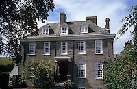 The grey brick facade of a Georgian country house