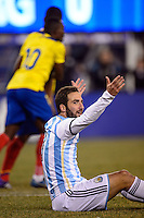 Argentina forward Gonzalo Higuain (9) reacts to not getting a foul call during the second half against Ecuador. Argentina and Ecuador played to a 0-0 tie during an international friendly at MetLife Stadium in East Rutherford, NJ, on November 15, 2013.