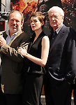 HOLLYWOOD, CA - JULY 07: Hans Zimmer, Anne Hathaway, Michael Caine attend the Christopher Nolan Hand & Footprint Ceremony At Grauman's Chinese Theatre on July 7, 2012 in Hollywood, California.
