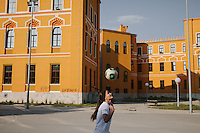 Mery Tanovic, a football player for U-19 Women National Team of Bosnia and Herzegovina, practices her skill at the back of Old Gymnasium in Mostar.