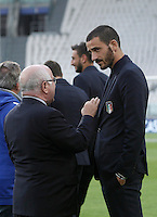 Italy's Leonardo Bonucci, right, listens to Italian Soccer Federation (FIGC) president Carlo Tavecchio during the walk around the pitch of the Juventus Stadium, ahead of the FIFA World Cup 2018 qualification match against Spain, in Turin, 5 October 2016.<br /> <br /> <br /> UPDATE IMAGES PRESS/Isabella Bonotto