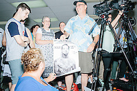 People hold a parody poster while Texas senator and Republican presidential candidate Ted Cruz speaks to a crowd at the kick-off event at his New Hampshire campaign headquarters in Manchester, New Hampshire. Cruz mentioned the poster and said how much he liked it.