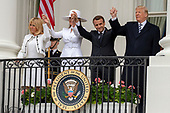 United States President Donald J. Trump, French President Emmanuel Macron, first lady of the United States Melania Trump, and first lady of France Brigette Macron, wave from the Truman Balcony of the White House 24, 2018 in Washington, DC. Credit: Alex Edelman / Pool via CNP
