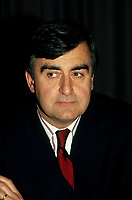 Montreal (Qc) CANADA -<br /> <br /> Lucien Bouchard, in an undated file photo circa 1990<br /> <br /> Bouchard joined Mulroney's Progressive Conservative government in 1988 as Secretary of State and later Minister of the Environment, serving until 1990. While still a strong Quebec nationalist, he believed that Mulroney's Meech Lake Accord was sufficient to placate nationalist feelings and keep Quebec in confederation.<br /> <br /> However, after a commission headed by Jean Charest recommended some changes to the Accord, Bouchard left the Progressive Conservatives (May 1990), feeling that the spirit and objectives of Meech were being diluted. Mulroney felt betrayed by Bouchard, and rejected his reasoning, having heard from a friend that Bouchard planned on leaving days before the Commission's report. In fact, in his memoirs Mulroney stated that trusting Bouchard was his most regretful and costliest mistake as Prime Minister. After the failure of Meech, Bouchard formed the sovereigntist Bloc Qu&raquo;b&raquo;cois, initially a faction of disaffected, separatist federal MPs and later a full-blown party, which attracted a variety of former Liberals and Conservatives.