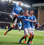 Emerson Hyndman scores the winning goal for Rangers and celebrates with James Tavernier and Jason Holt