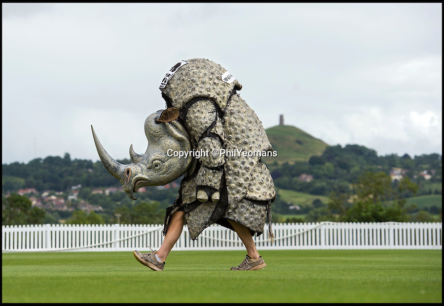 BNPS.co.uk (01202 558833)<br /> Pic: PhilYeomans/BNPS<br /> <br /> Last minute training for Millfield School teacher David Trevis before he undertakes a mammoth 130 mile challenge to traverse Devon next week ...dressed as a Rhinocerous.<br /> <br /> Schoolteacher David Trevis has taken on the hard 'tusk' to raise funds for Save the Rhino and Marwell Wildlife. <br /> <br /> He will spend nine days hiking from the south Devon coast across Dartmoor and Exmoor before finishing up in Lynmouth.<br /> <br /> https://crowdfunding.justgiving.com/david-trevis