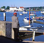 AREJJE Man looking out over boats on River Deben Woodbridge Suffolk England
