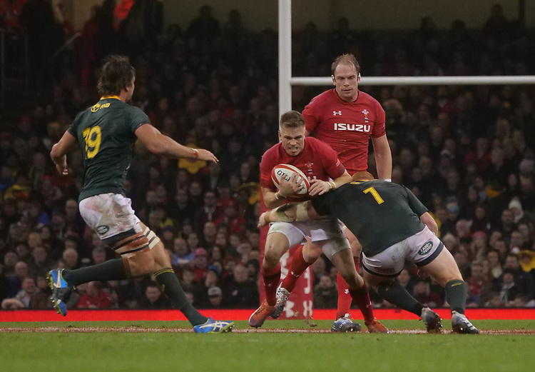 Wales' Gareth Anscombe is tackled by South Africa's Pieter-Steph Du Toit<br /> <br /> Photographer Ian Cook/CameraSport<br /> <br /> Under Armour Series Autumn Internationals - Wales v South Africa - Saturday 24th November 2018 - Principality Stadium - Cardiff<br /> <br /> World Copyright © 2018 CameraSport. All rights reserved. 43 Linden Ave. Countesthorpe. Leicester. England. LE8 5PG - Tel: +44 (0) 116 277 4147 - admin@camerasport.com - www.camerasport.com