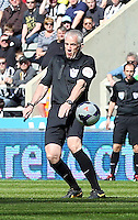 Pictured: Referee Chris Foy the moment he got knocked over by a Fabricio Coloccini of Newcastle deflection from a Jonjo Shelvey shot of Swansea. Saturday 19 April 2014<br /> Re: Barclay's Premier League, Newcastle United v Swansea City FC at St James Park, Newcastle, UK.