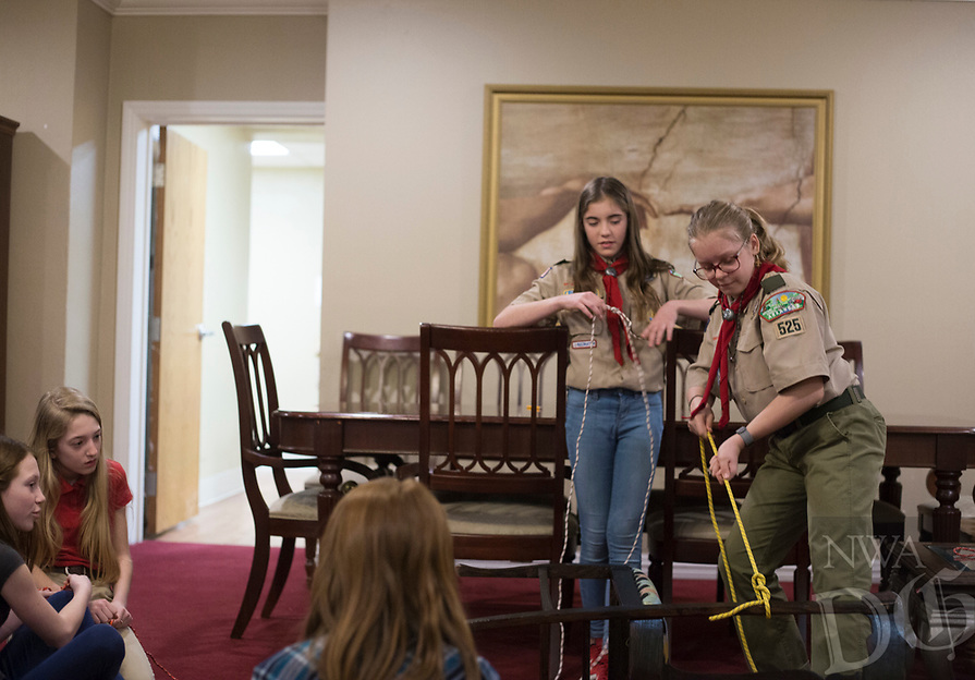 NWA Democrat-Gazette/CHARLIE KAIJO Annabella Rose Tyburski and Ruby Freeman (from right) demonstrate how to tie a knot as Ava Ahern and Stella Decker (from left) observe during a family scouting open house, Monday, February 4, 2019 at First United Methodist Church in Bentonville.