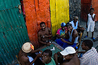 Haitian men play dominoes on the street close to the La Saline market in Port-au-Prince, Haiti, 14 July 2008.