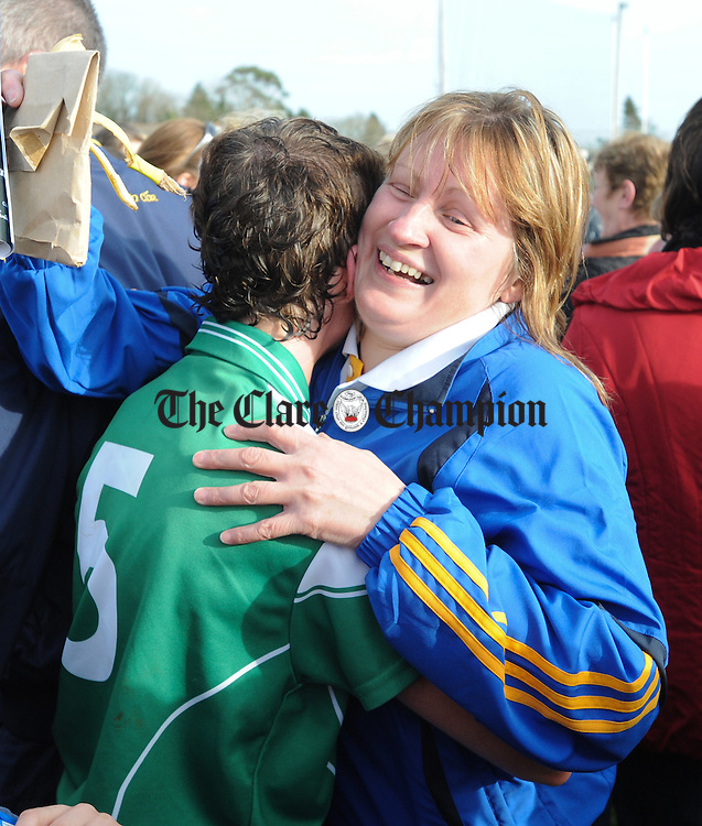 Inagh manager Ann Wynne celebrates the win with players Patsy Mc Carthy following their All-Ireland Junior Club Championship semi final win over Four Roads at Clarecastle. Photograph by John Kelly.