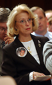 Washington, D.C. - March 23, 2004 -- Elaine Hughes of Long Island, New York, whose son, Kris Robert Hughes, was on the 89th floor of the South Tower of the World Trade Center on September 11, 2001, listens to testimony before the National Commission on Terrorist Attacks Upon the United States during its 8th Public Hearing in Washington, D.C. on March 23, 2004.<br /> Credit: Ron Sachs / CNP<br /> [RESTRICTION: No New York Metro or other Newspapers within a 75 mile radius of New York City]