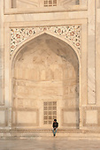 Agra, Uttar Pradesh, India. A man sitting in the alcove of the Taj mahal.