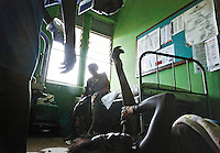 Maternity Ward at Mulago Hospital in Kampala.  Head of OB/GYN is Josaphat Byamugisha.  Josaphat was taught by Jotham Musinguzi who became head of Population and Development Dept. for the government.  Jotham recently retired because he did not agree with the current president Yoweri Kaguta Museveni. Museveni has a military background and just wants to get BOOTS ON THE GROUND. Jotham said he wants to bump Uganda's population up to 60M before he even starts to worry about infrastructure for all those people. Uganda is about 30M now.  About half of Uganda's population is under 15 and life expectancy is about 50.  Population has doubled from 1990 to now.