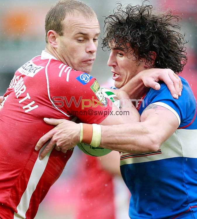 PICTURE BY CHRIS MANGNALL /SWPIX.COM...Rugby League - Super League  - Salford City Reds v Hull Kingston Rovers - Salford City Stadium , Eccles, England  - 09/04/12... Salford's  Daniel Holdsworth tackled by  Hull's Dave Patersen