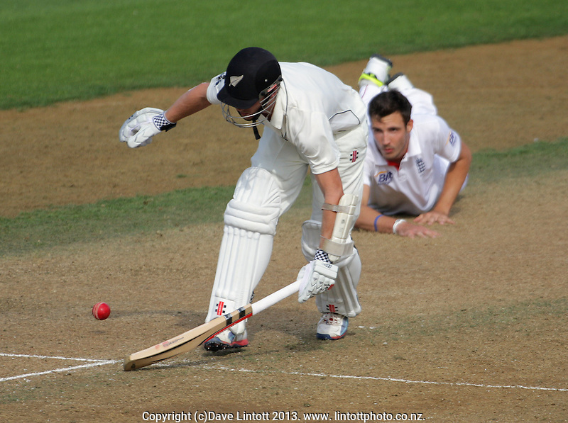 Kane Williamson makes his ground as Steven Finn looks on during day three of the 2nd cricket test match between the New Zealand Black Caps and England at the Hawkins Basin Reserve, Wellington, New Zealand on Saturday, 16 March 2013. Photo: Dave Lintott / lintottphoto.co.nz