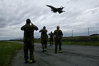 Territorial Army soldiers watch as F-16 planes land. BOLD AVENGER 2007 (BAR 07), a NATO  air exercise at Ørland Main Air Station, Norway. BAR 07 involved air forces from 13 NATO member nations: Belgium, Canada, the Czech Republic, France, Germany, Greece, Norway, Poland, Romania, Spain, Turkey, the United Kingdom and the United States of America...The exercise was designed to provide training for units in tactical air operations, involving over 100 aircraft, including combat, tanker and airborne early warning aircraft and about 1,450 personnel.
