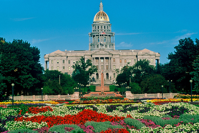 Summer in Denver's Civic Center Park, where the grounds are in full bloom, in front of the Colorado State Capitol Building, Denver, Colorado.