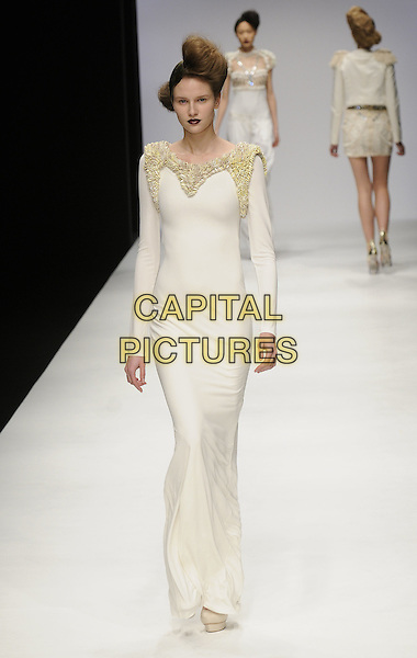 MODEL.At the Sass & Bide Fashion Show during Day 1 of London Fashion Week, BFC Show Space, Somerset House, London, England, UK, February 19th 2009..LFW full length catwalk runway platform shoes modeling  cream dress sleeved sleeves .long maxi.CAP/CAN.©Can Nguyen/Capital Pictures