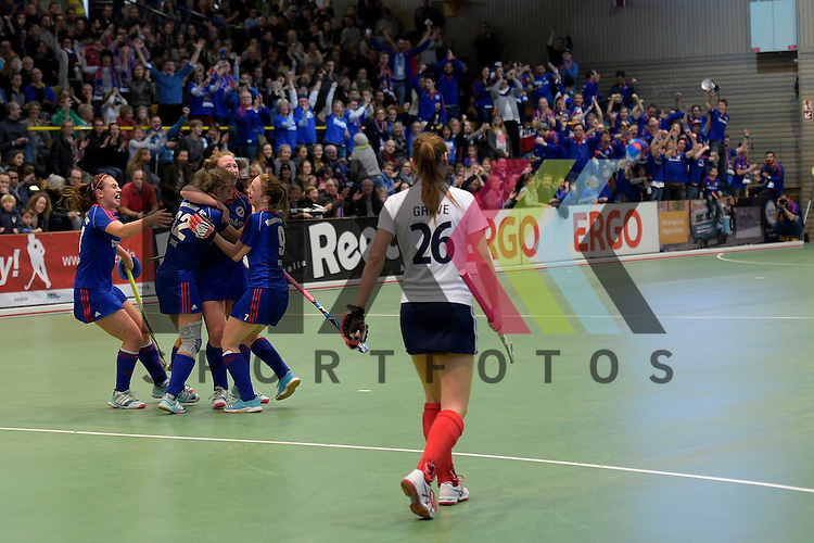 GER - Luebeck, Germany, February 07: During the 1. Bundesliga Damen indoor hockey final match at the Final 4 between Mannheimer HC (blue) and Duesseldorfer HC (white) on February 7, 2016 at Hansehalle Luebeck in Luebeck, Germany. Final score 6-4 after shootout.  Lydia Haase #12 of Mannheimer HC congratulated by teammates after scoring a penalty corner