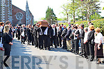 FINAL JOURNEY: The remains of Bill Kirby.are shouldered from St John's Church in.Tralee on Tuesday morning.