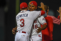 Manager Darren Fenster (3) and catcher Roldani Baldwin (16) of the Greenville Drive embrace after the win in Game 3 of the South Atlantic League Southern Division Playoff against the Charleston RiverDogs on Saturday, September 9, 2017, at Fluor Field at the West End in Greenville, South Carolina. Greenville won, 5-0, winning the division championship two games to one. (Tom Priddy/Four Seam Images)