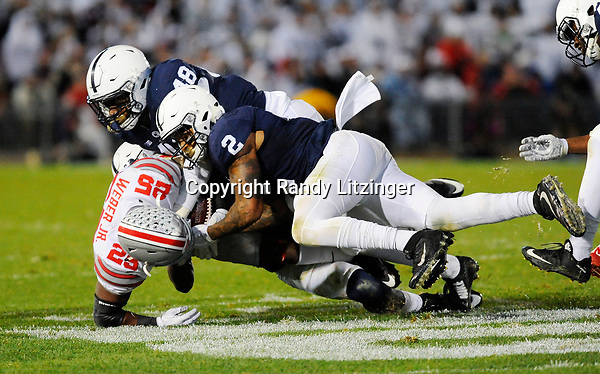 STATE COLLEGE, PA - OCTOBER 22:  Penn State S Marcus Allen (2) tackles and tries to strip Ohio State RB Mike Weber (25). The Penn State Nittany Lions upset the #2 ranked Ohio State Buckeyes 24-21 on October 22, 2016 at Beaver Stadium in State College, PA. (Photo by Randy Litzinger/Icon Sportswire)