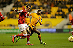Aden Flint of Bristol City competes with Bright Enobakhare of Wolves - Football - Wolverhampton Wanderers vs Bristol City - Molineux Wolverhampton - Sky Bet Championship - 8th March 2016 - Season 2015/2016 - Picture Malcolm Couzens/Sportimage
