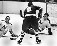 Seals Bill Hicke ready to shoot on Minnesota North Star goalie Gump Worsley. #20 on ice...(1970 photo/Ron Riesterer)