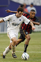 The Rapids' Jordan Cila is chased by the MetroStars' Ricardo Clark. The Colorado Rapids defeated the NY/NJ MetroStars 3 to 2 at Giant's Stadium, East Rutherford, NJ, on June 30, 2004.
