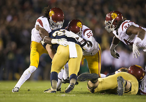 October 19, 2013:  USC linebacker Lamar Dawson (55) tackles Notre Dame running back Cam McDaniel (33) during NCAA Football game action between the Notre Dame Fighting Irish and the USC Trojans at Notre Dame Stadium in South Bend, Indiana.  Notre Dame defeated USC 14-10.