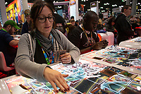 NEW YORK, USA - October 3: A woman plays cards during day one of New York Comic Con on October 3, 2019 in New York, USA.<br /> The 2019 New York Comic-Con at the Jacob K. Javits Convention Center Day 1 with the latest in superhero movies, sci-fi shows, animation, video games, comic book releases available to attendees.<br /> (Photo by Luis Boza/VIEWpress/Corbis via Getty Images)