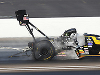 Sep 4, 2017; Clermont, IN, USA; Fluid leaks from the engine on the dragster of NHRA top fuel driver Tony Schumacher during the US Nationals at Lucas Oil Raceway. Mandatory Credit: Mark J. Rebilas-USA TODAY Sports