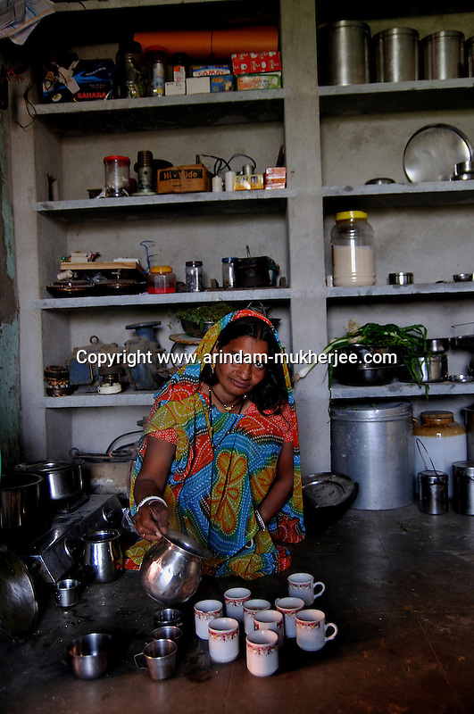 Nirmala is a worker of 'Sadhna' staying at Sheesvi village near Udaipur. She is attached to Sadhna for a long time. She is a hard working woman. She helped her husband with her earning money to build a two storied house along with a small shop. While running the shop she does her assignments given by Sadhna. Udaipur,  Rajasthan, India. 25.1. 2011. Arindam Mukherjee.