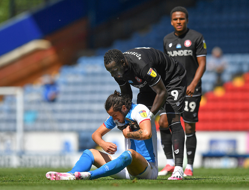 Bristol City's Famara Diedhiou tries to help Blackburn Rovers' Lewis Travis back to his feet<br /> <br /> Photographer Dave Howarth/CameraSport<br /> <br /> The EFL Sky Bet Championship - Blackburn Rovers v Bristol City - Saturday 20th June 2020 - Ewood Park - Blackburn<br /> <br /> World Copyright © 2020 CameraSport. All rights reserved. 43 Linden Ave. Countesthorpe. Leicester. England. LE8 5PG - Tel: +44 (0) 116 277 4147 - admin@camerasport.com - www.camerasport.com