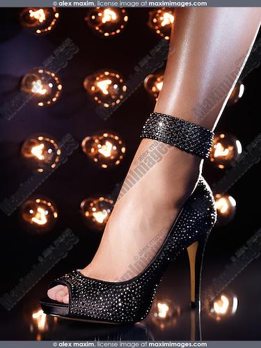 Closeup of a woman leg wearing a luxury high heel shoe on a dance floor