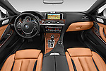 Stock photo of straight dashboard view of a 2015 BMW 6 Series Experience 2 Door Coupe Dashboard