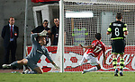 Maaran Lala scores past Artur Boruc for Hapoel's second goal