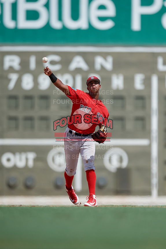 Boston Red Sox shortstop Antoni Flores (15) throws to first base during a Florida Instructional League game against the Baltimore Orioles on September 21, 2018 at JetBlue Park in Fort Myers, Florida.  (Mike Janes/Four Seam Images)
