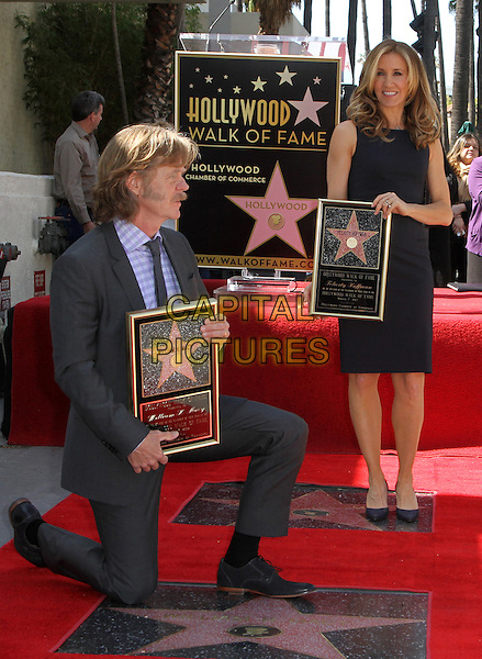 William H. Macy & Felictiy Huffman .Felictiy Huffman And William H. Macy Hollywood Walk Of Fame Induction Ceremony Held At On the Walk of Fame, Hollywood, California, USA.  .March 7th, 2012.full length moustache mustache facial hair married husband wife black suit dress suit kneeling profile.CAP/ADM/KB.©Kevan Brooks/AdMedia/Capital Pictures.