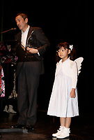 Director Eiji Okuda (R) give flower to his daugher (L_)who plays in his movie NAGAI SANPO (A LONG WALK) who won ex-aequo the Grand Prize of the America at the Montreal World Film Festival (Festival des Films du Monde de Montreal