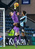 Goalkeeper Callum Preston of Crawley Town saves under pressure from Aaron Amadi-Holloway of Wycombe Wanderers during the Sky Bet League 2 match between Wycombe Wanderers and Crawley Town at Adams Park, High Wycombe, England on 28 December 2015. Photo by Andy Rowland / PRiME Media Images