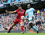 Manchester City's Benjamin Mendy tussles with Liverpool's Emre Can during the premier league match at the Etihad Stadium, Manchester. Picture date 9th September 2017. Picture credit should read: David Klein/Sportimage