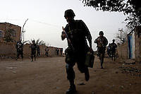 Iraqi Minister of Interior Special Police Commandos from  2nd Company, 2nd Battalion, 2nd Brigade  run to position while supporting the US Army 1st batt, 506th, 101st airborne div on a battalion size operation with the purpose of drawing insurgents to the open and destroying them from static observation posts and air support in  the Mul'Hab neighborhood of Eastern Ramadi, Al Anbar Province, Iraq on Sunday Feb 11 2006. 2nd Company came under fire during the operation returning several hundred  rounds back to the insurgents that were approaching them on civilian vehicles armed with machine guns. one hour in the operation an Iraqi senior non commissioned officer fired accidentally (  tech therm: negligent discharge) his AK 47 automatic rifle almost wounding several comrades and US military trainers that where operating next to him. the unit continued the mission making several tactical mistakes that opened the way for a suspected insurgent vehicle to approach from  close distance and fire accurately on the unit that was on an open street without cover. Two Commandos suffered injuries and were evacuated by the US Army Medivac system. A third received two rounds in his back armor plate but suffered no injuries. The operation lasted several more hours but after the accident the Commandos relaxed even further providing  very ineffective security.   The insurgency operates extensively in the Mul'Hab neighborhood attacking the coalition  and  Iraqi forces on a regular  bases.