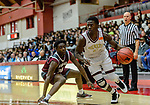 WEST HARTFORD, CT. 15 March 2018-031518BS28 - Raheem Solomon (11) from Sacred Heart dribbles around Jarrell Petteway (14) from Windsor at the Div I semi-finals between Sacred Heart vs Windsor at University of Hartford on Thursday evening. Sacred Heart won in a thriller 59-58 over Windsor and advances to the finals at Mohegan Sun. Bill Shettle Republican-American