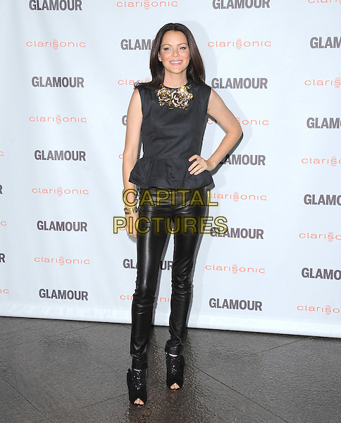 Jacinda Barrett.The Glamour Reel Moments held at The Directors Guild of America in West Hollywood, California, USA..October 24th, 2011.full length black leather trousers open toe ankle boots top grey gray gold rose flower collar jewellery jewelry necklace sleeveless hand on hip  .CAP/RKE/DVS.©DVS/RockinExposures/Capital Pictures.